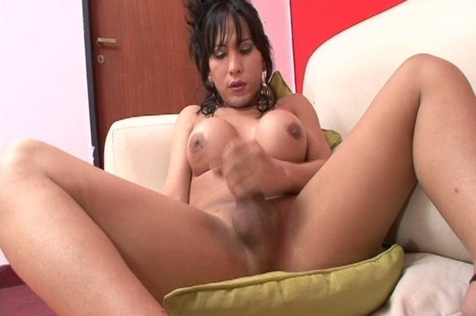 Latina Tranny Stroking Her Cock On Sofa